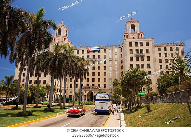 View to the Hotel Nacional in Vedado district with an Vintage American car used as taxi in the foreground, La Habana, Cuba, West Indies, Central America