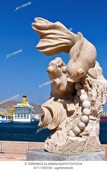 An artistic fish sculpture on the harbourfront promenade in Muscat, Oman