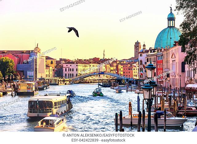 Scalzi bridge and the Grand Canal with vaporetto, gondolas, boats and tourists, Venice, Italy