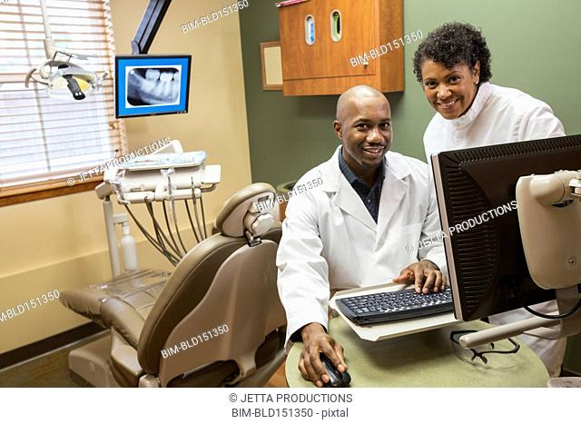 Dentists using computer in office