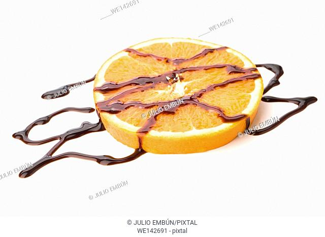 portions of fresh orange flooded in chocolate on white background