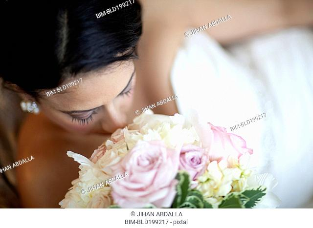 Egyptian bride smelling bouquet