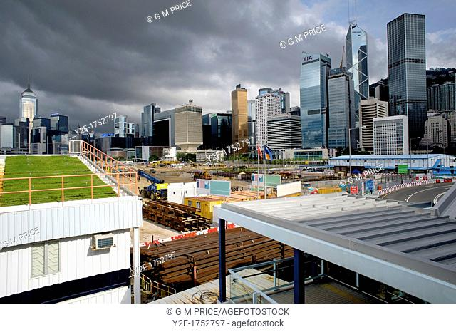 sunlight and storm clouds: view of Hong Kong city across new urban construction in Central district