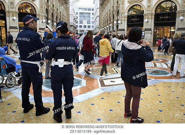 Vittorio Emanuele gallery interior, Milan, Italy. Police patrolling the interior to reinforce security