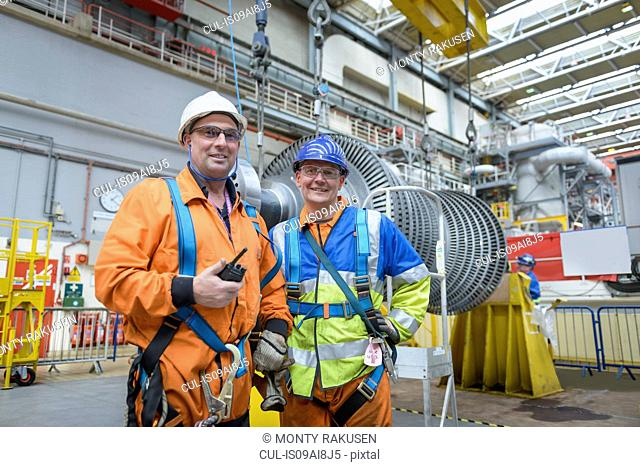 Banksman and crane operator in turbine hall during power station outage, portrait