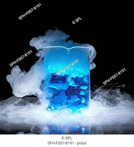 Dry ice vaporising (subliming). Carbon dioxide is a colourless gas at room temperature but becomes a liquid under compression