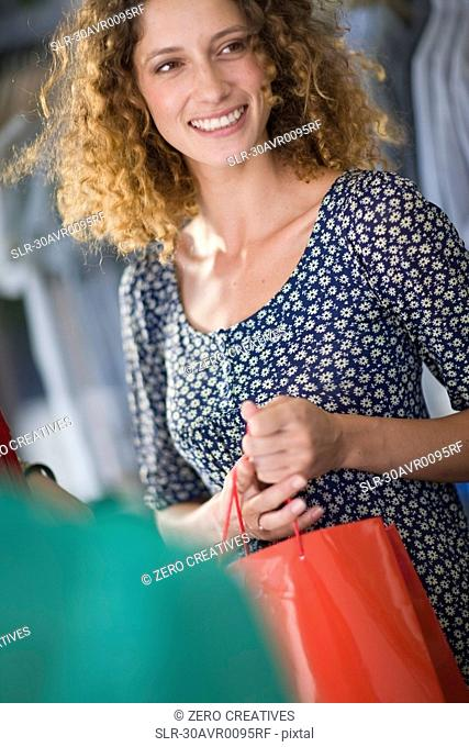 Woman on shopping tour smiling