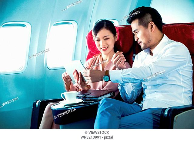 Business men and women by plane