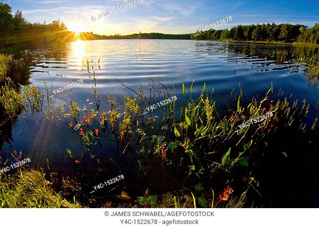 Sunset over Twin Pond in Old Forge in the Adirondack Mountains of New York State