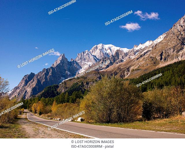 Road by rural mountain range