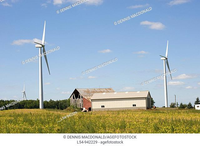 Agricultural Wind Farm farms turbine produces kinetic energy in wind into mechanical energy converting wind to electricity in Michigan near Ubly Michigan