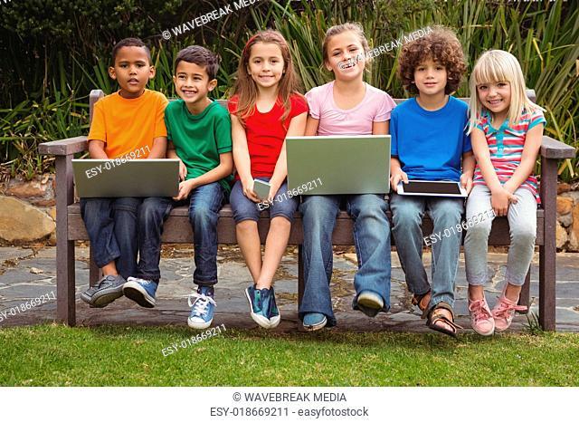 Kids sitting on a park bench