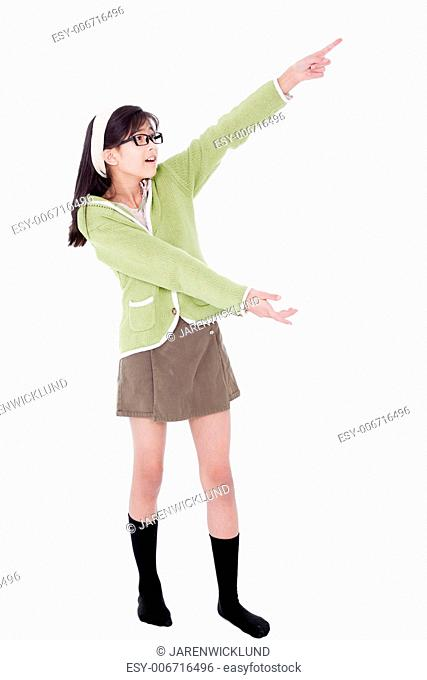 Asian biracial girl in green sweater pointing to something off to the side, isolated