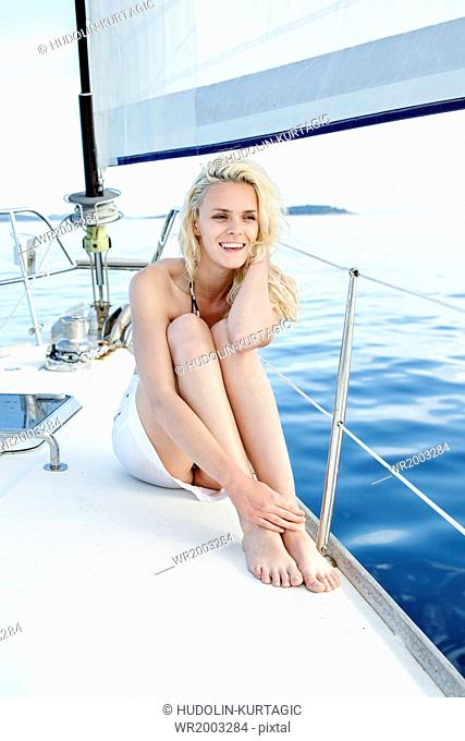 Young woman day dreaming on sailboat, Adriatic Sea