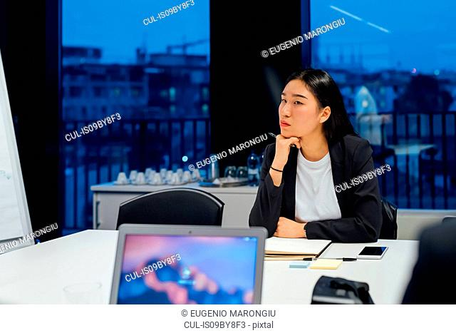 Businesswoman listening at conference table meeting