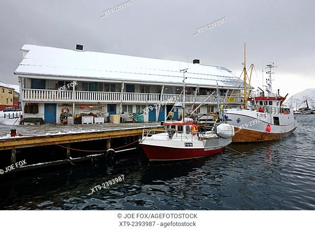 old warehouses and small fishing boats Honningsvag harbour finnmark norway europe