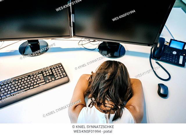 Exhausted businesswoman sleeping on desk
