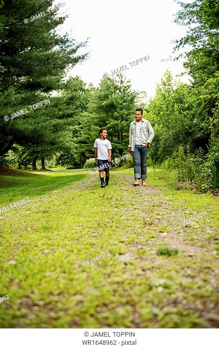 Two brothers walking on a country path
