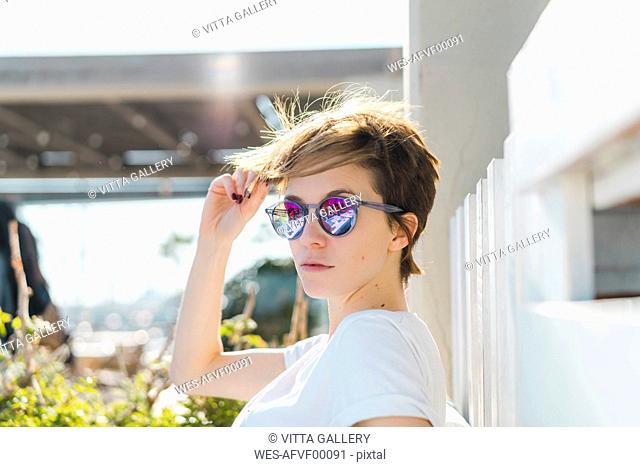 Portrait of woman wearing mirrored sunglasses