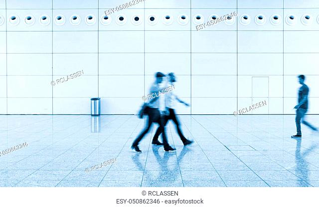 blurred people walking at a floor. ideal for websites and magazines layouts