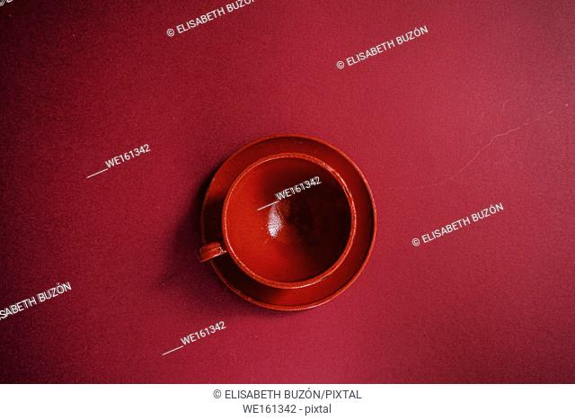 Cup and plate red of glass