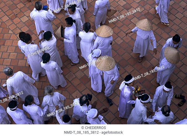 High angle view of monks in a courtyard, Vietnam