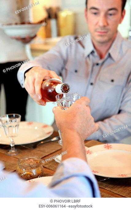 Man pouring wine during meal