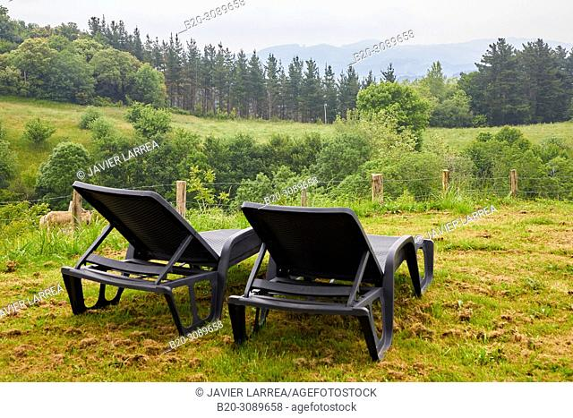 Deck chairs with mountain views, Rural apartment, Deba, Gipuzkoa, Basque Country, Spain, Europe