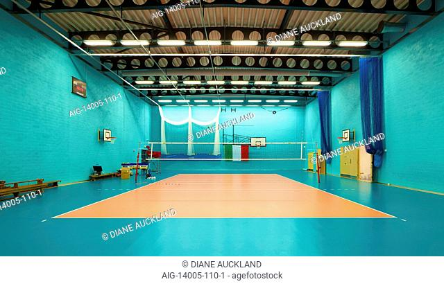 Brightly painted sports hall in Leyton Sixth Form College Redevelopment, UK