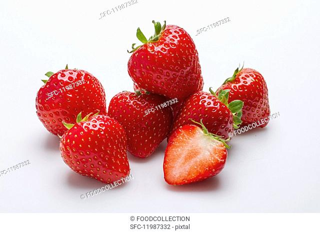 Several strawberries against a white background