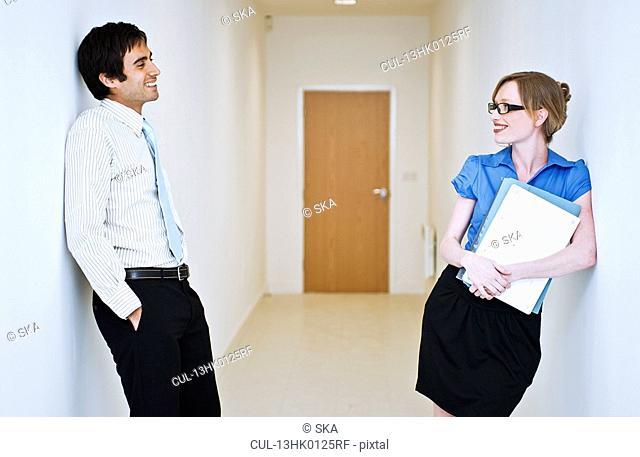 couple chatting in corridor