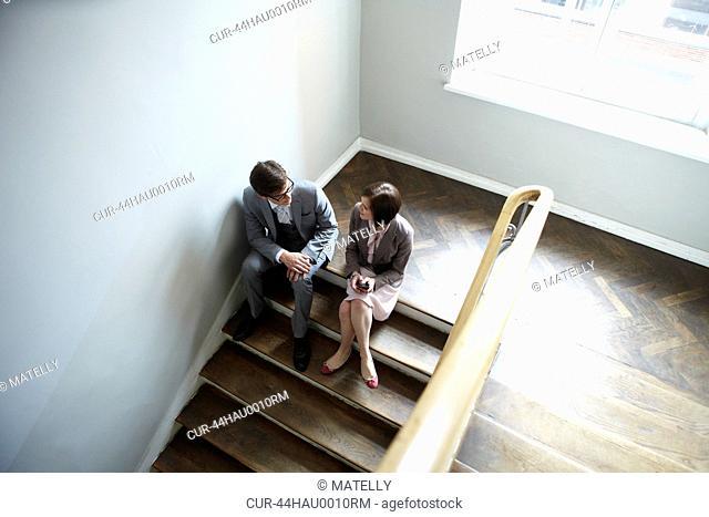 Business people talking on steps