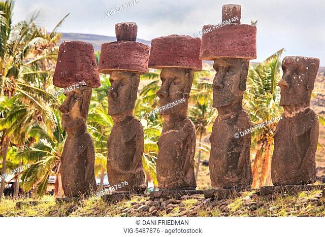 Moai statues with red scoria topknots on Ahu Nau Nau at Anakena Beach on Easter Island, Chile. - EASTER ISLAND, CHILE, 17/03/2010