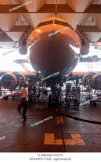 Aeroplane ; An Indian Airlines aircraft undergoing repairs at the domestic airport workshop at Santacruz ; in the western suburb in Bombay ; now Mumbai city ;...