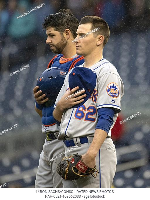"""New York Mets catcher Kevin Plawecki (26), left, and relief pitcher Drew Smith (62), right, stand at attention as """"""""God Bless America"""""""" is sung during the..."""