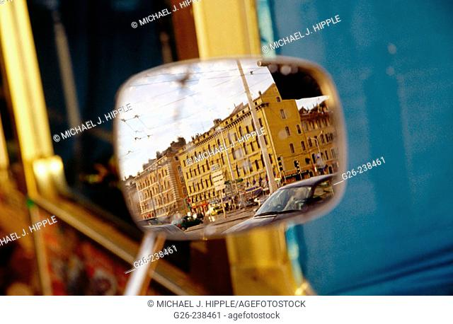 Reflection of buildings in a motorcycle mirror. Marseille. Provence. France