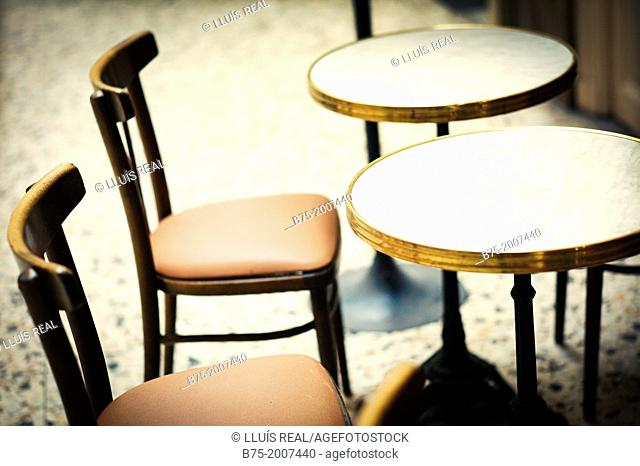 Two chairs and two tables vintage, typical of a bar in Paris