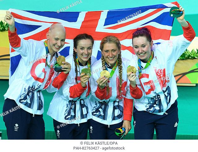 Team of Great Britain consisting of Katie Archibald, Laura Trott (2nd R), Elinor Barker and Joanna Rowsell-Shand celebrates on the podium after winning the...
