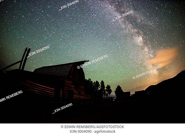 Celestial skies open up above T. A Moulton Barn, Grand Tetons National Park, Teton County, Wyoming. USA