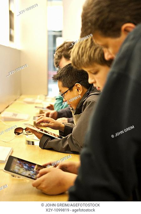 Customers explore the iPad in an Apple store on launch day, Cherry Hill Mall, NJ, USA  April, 3, 2010