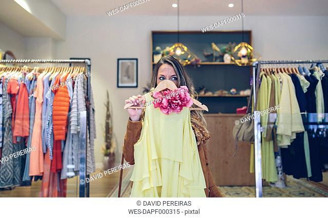 Woman holding dress in a boutique