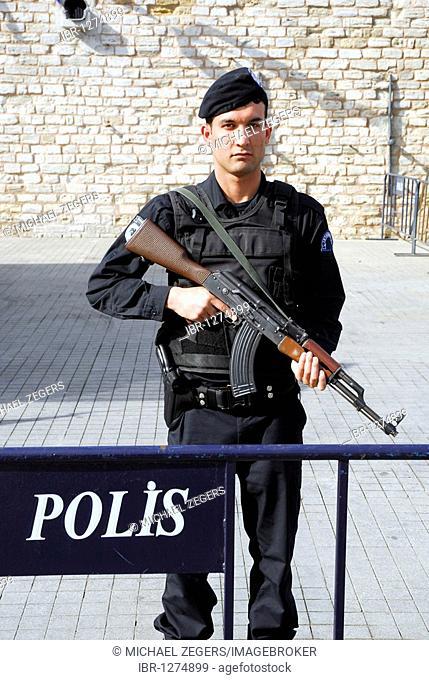 Turkish police officer on Taksim Square, Taksim Cumhuriyet Abidesi, Istanbul, Turkey