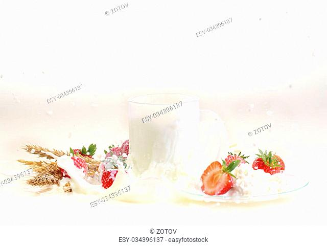 Strawberry and milk on a white background, milk in a transparent mug and cottage cheese with a strawberry