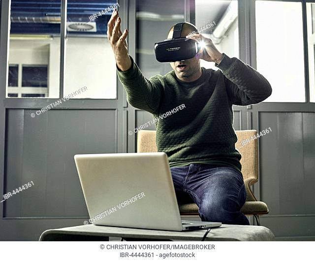 Man with VR goggles, virtual reality glasses
