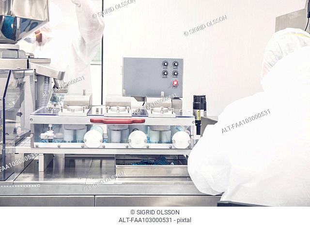 Technicians at work in prescription drug production facility
