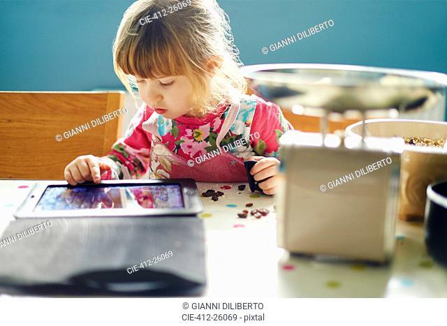 Curious girl using digital tablet
