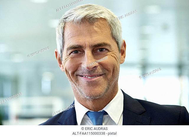 Close-up of businessman smiling