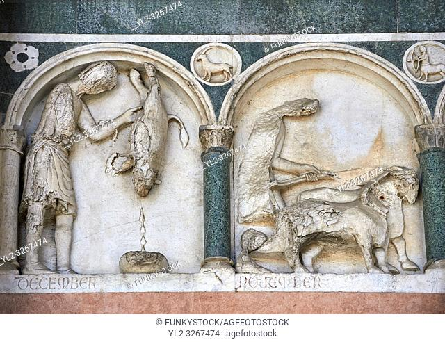 Late medieval relief sculpture depicting the labours for December and November and astrological signs on the Facade of the Cattedrale di San Martino