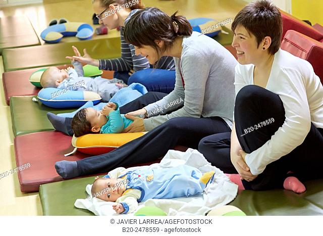 Mothers playing with babies at breastfeeding education program