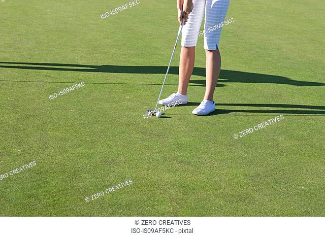 Cropped shot of young female golfer